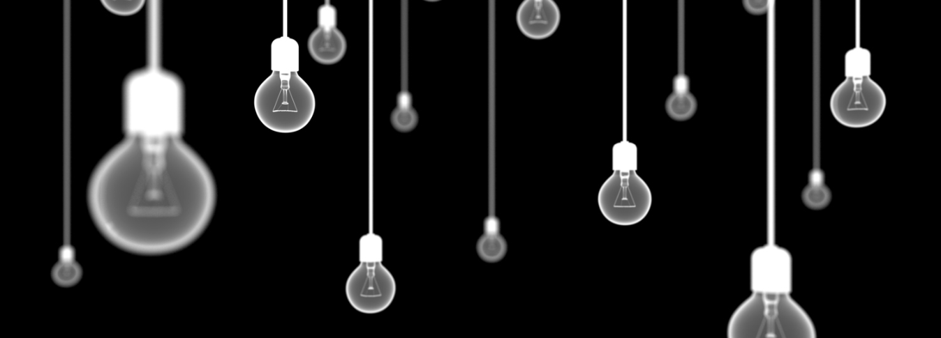 Image of hanging lightbulbs in a dark space