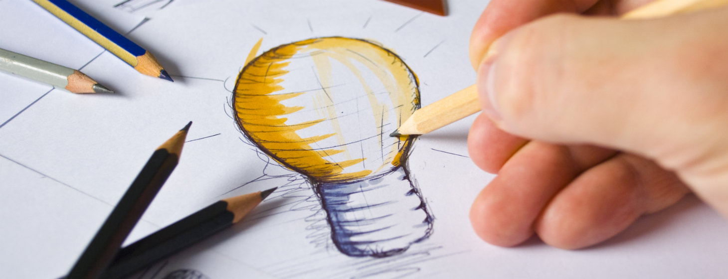 A UX Architect sketching out a bright idea