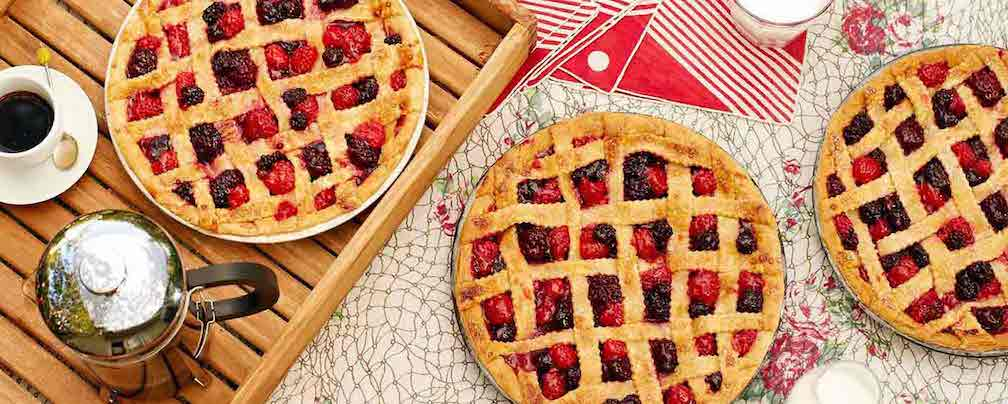 Three mixed berry pies