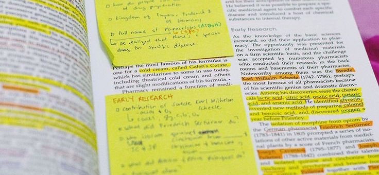 Post-its and highlight marks on book pages