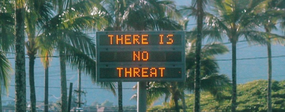 "Hawaiian billboard showing ""There is no threat"" message"