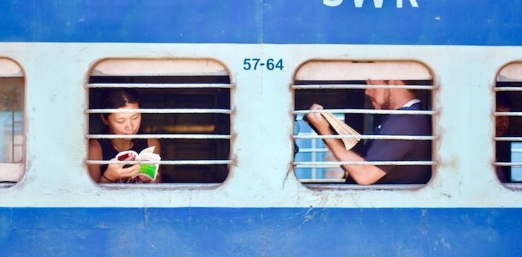 Train riders framed in their individual window screens