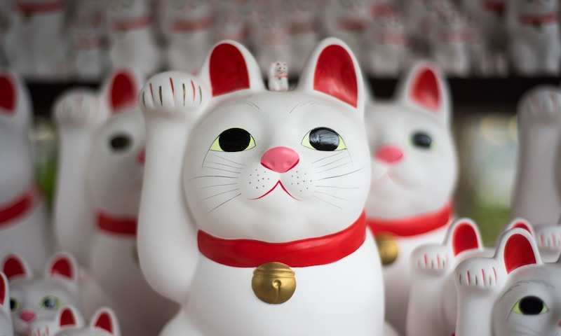 A collection of waving Japanese cat figurines