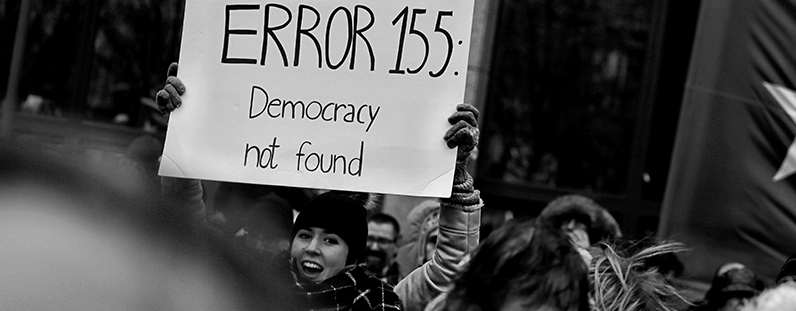 """Democracy not found"" protest sign"