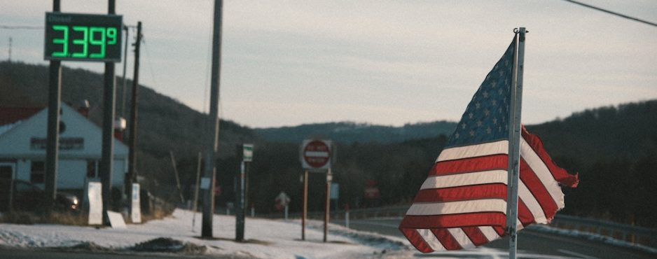 An aging flag flies in a small town