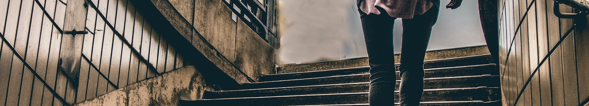 Woman escaping up a flight of stairs