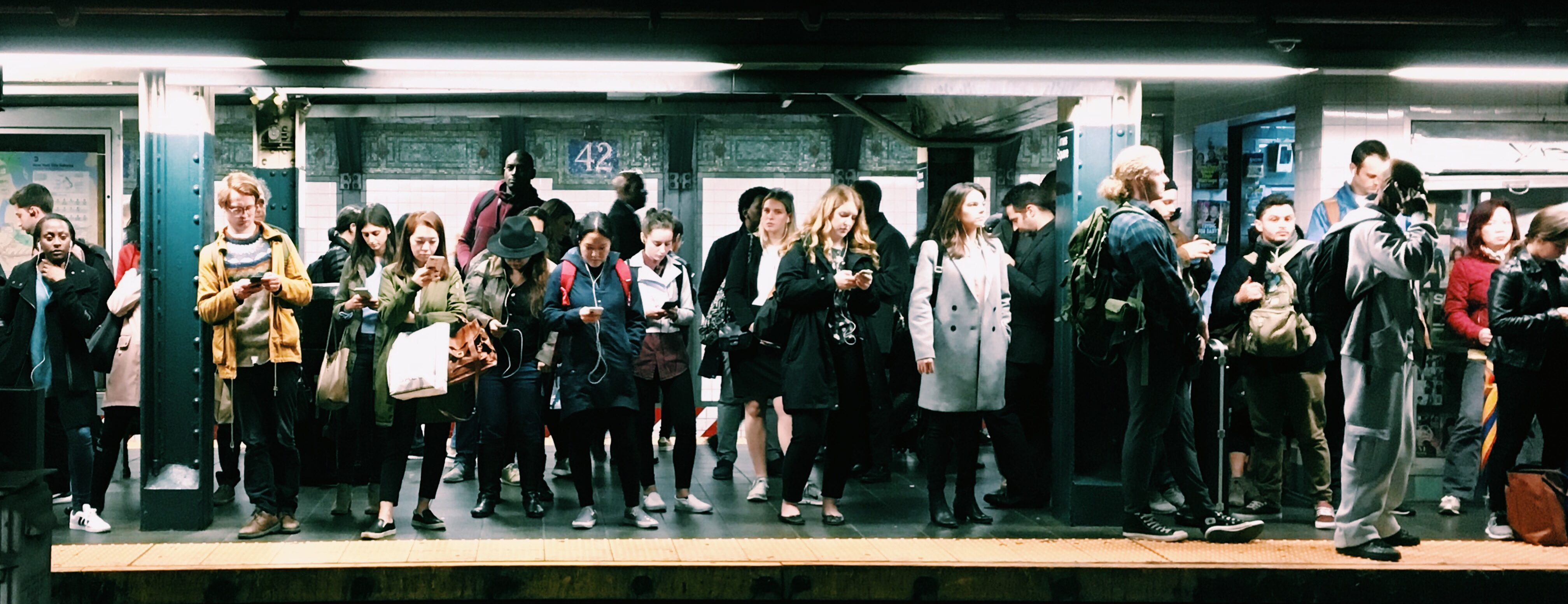 People waiting to test in a subway