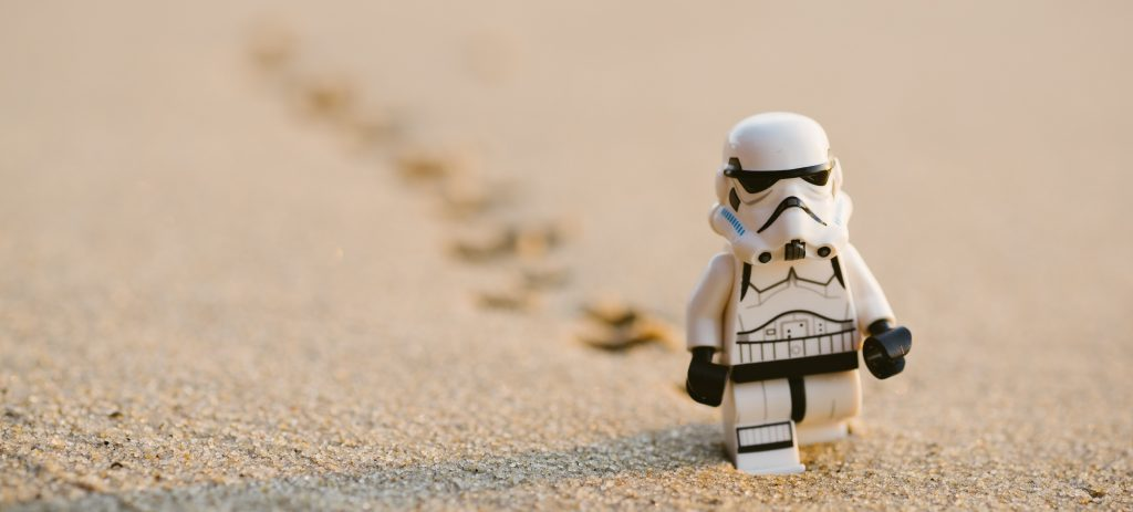 a Lego storm trooper walking along the beadh, contemplating his role in the Empire trymyui blog bad ux